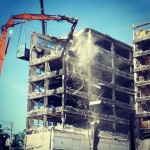 Photo of falling slabs of concrete at demolition of 3400 Montrose, 2014
