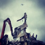 Photo of plane over demolition of 3400 Montrose, 2014