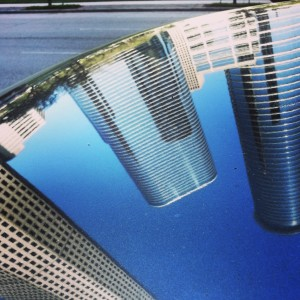 Photo of Houston's Allen Center reflected on my car roof