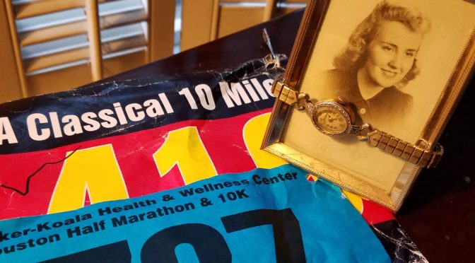 Two race bibs with photo of Mom